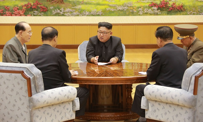 This picture taken on Sept. 3, 2017 and released by North Korea's official Korean Central News Agency shows North Korean leader Kim Jong-Un attending a meeting with a committee of the Workers' Party of Korea about the test of a hydrogen bomb. (STR/AFP/Getty Images)