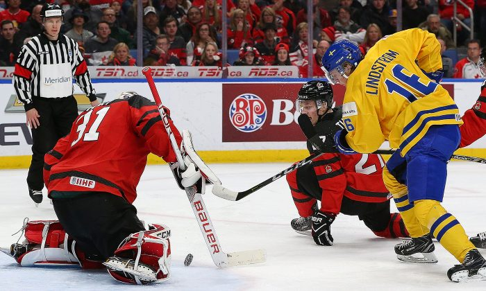 Carter Hart #31 of Canada makes the save against Linus Lindstrm #16 of Sweden during the Gold medal game of the IIHF World Junior Championship at KeyBank Center on Jan. 5, 2018 in Buffalo, New York. (Kevin Hoffman/Getty Images)