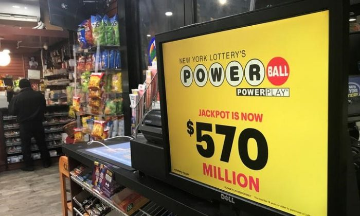 A Powerball sign is pictured in a store in New York City, New York, on Jan. 5, 2018. (REUTERS/Carlo Allegri)