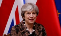 UK PM May Says Trump Committed to Best Interests of United States
