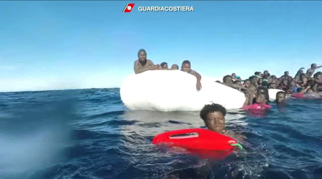 Migrants try to stay afloat after falling off their rubber dinghy during a rescue operation by Italian coast guard off Libya's coast, in this still image taken from a January 6, 2018 video. (Guardia Costiera/Handout via Reuters TV)