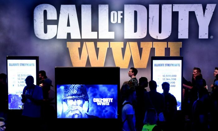 "Visitors wait at the stand of the computer game ""Call of Duty"" during the gaming fair ""gamescom"" in Cologne, western Germany on Aug. 22, 2017. (Patrik Stollarz/AFP/Getty Images)"