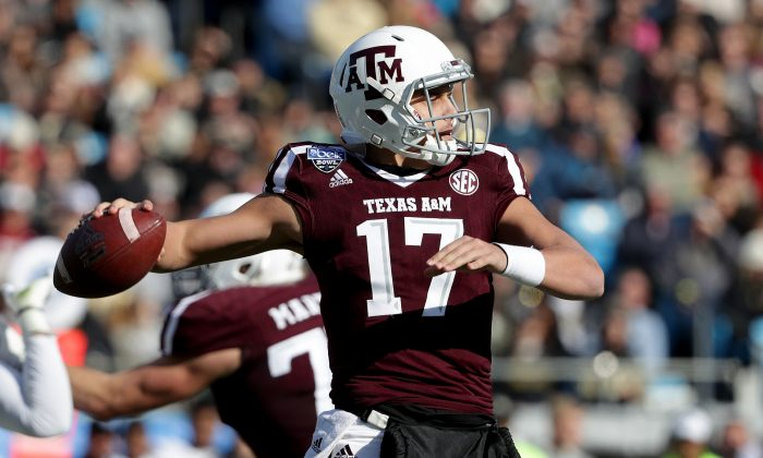 Nick Starkel #17 of the Texas A&M Aggies drops back to pass against the Wake Forest Demon Deacons during the Belk Bowl at Bank of America Stadium on December 29, 2017 in Charlotte, North Carolina. (Streeter Lecka/Getty Images)