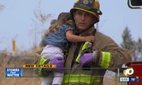 Firefighter Called a Hero for Comforting Little Girl After Crash