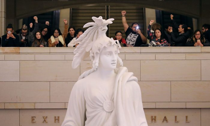 Demonstrators from The Seed Project stage a protest in the U.S. Capitol Visitors Center to demand immigration reform and a renewal of the Deferred Action for Childhood Arrivals (DACA) program December 7, 2017 in Washington, DC. (Chip Somodevilla/Getty Images)