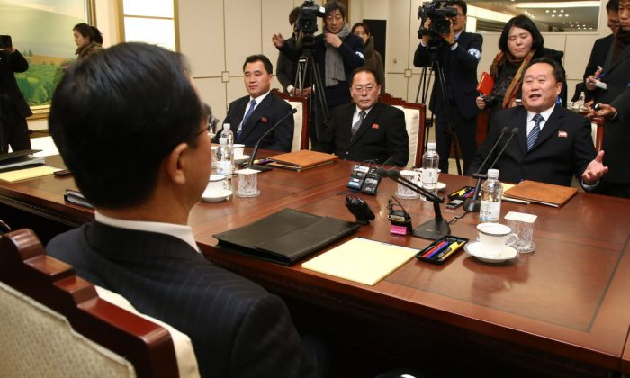 North Korean chief delegate Ri Son-Gwon (R) talks with South Korea Unification Minister Cho Myung-Gyun (front L) during their meeting at the border truce village of Panmunjom in the Demilitarized Zone (DMZ) dividing the two Koreas on Jan. 9, 2018. North and South Korea began their first official talks in more than two years on Jan. 9, focussing on the forthcoming Winter Olympics after months of tensions over Pyongyang's nuclear weapons programme. (Korea Pool/AFP/Getty Images)