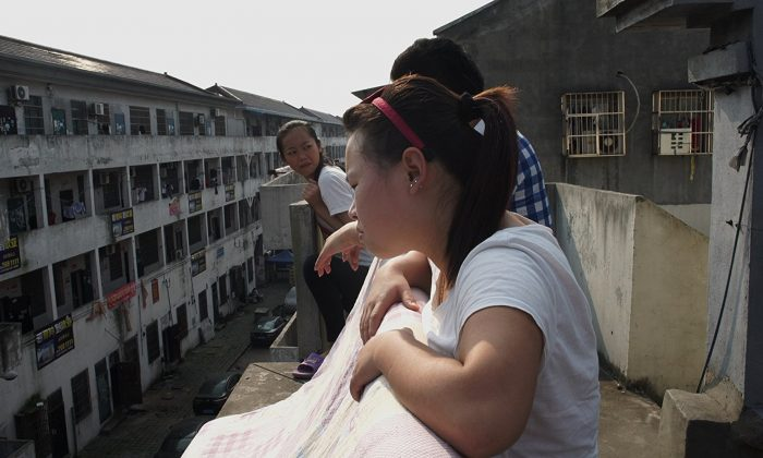"A still shot from the fllm ""Bitter Money,"" showing the dormitories that house migrant textile workers in China. (House on Fire)"
