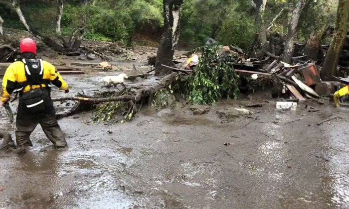 Emergency personnel search through debris and mudflow in this still photo taken from video provided by the Santa Barbara County Fire Department after a mudslide in Montecito, Calif., on Jan. 9, 2018. (Courtesy of the Santa Barbara County Fire Department)