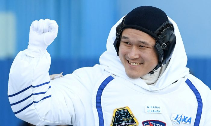 Norishige Kanai of the Japan Aerospace Exploration Agency (JAXA) during the send-off ceremony  before the launch of the Soyuz MS-07 spacecraft at the Baikonur cosmodrome, in Kazakhstan, 17 December 2017.  (Reuters/Kirill Kudryavtsev/Pool/File Photo