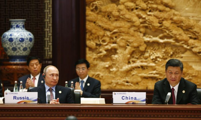 Russian President Vladimir Putin and Chinese leader Xi Jinping attend a summit at the Belt and Road Forum in Beijing, China on May 15, 2017. (Thomas Peter-Pool/Getty Images)