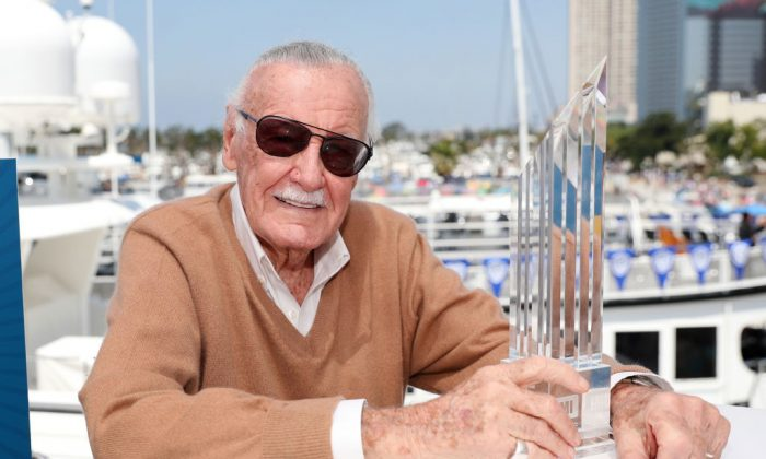 Stan Lee poses with the first IMDb STARmeter Award for Lifetime Achievement on the #IMDboat at San Diego Comic-Con 2017 on the IMDb yacht on July 21, 2017, in San Diego, Calif. (Rich Polk/Getty Images for IMDb)