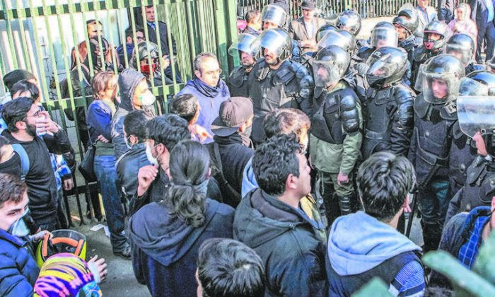 Iranian students protest at the University of Tehran in the capital, Tehran, on Dec. 30, 2017. (STR/AFP/GETTY IMAGES)