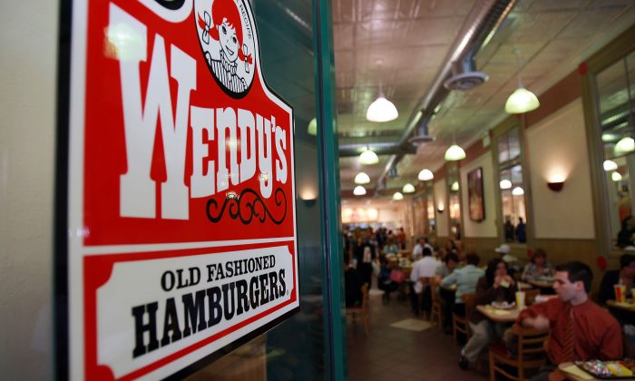 People eat in a Wendy's. (Spencer Platt/Getty Images)