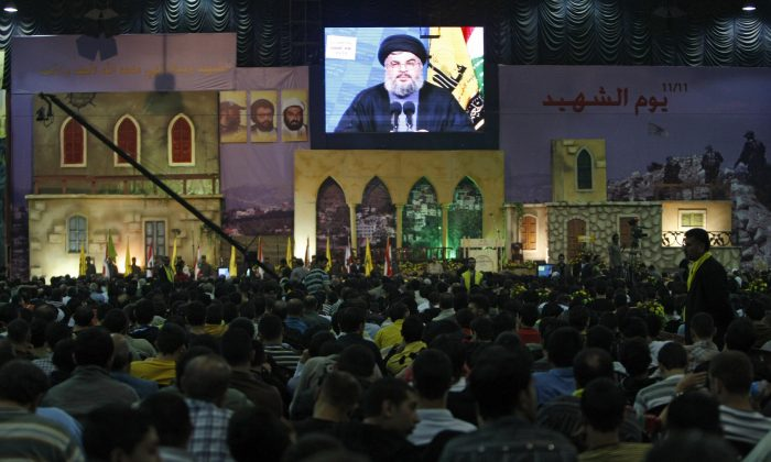Supporters of the Hezbollah terror group listen to leader Hassan Nasrallah in a televized speech during a commemoration of Hezbollah's Martyrs Day in Beirut's southern suburb on Nov. 11, 2008. (RAMZI HAIDAR/AFP/Getty Images)