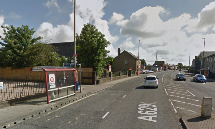 Wakefield Road in Moldgreen, West Yorkshire, pictured at the location of an accident on Jan. 10, 2018 that destroyed the bus shelter.  (Screenshot/GoogleMaps)