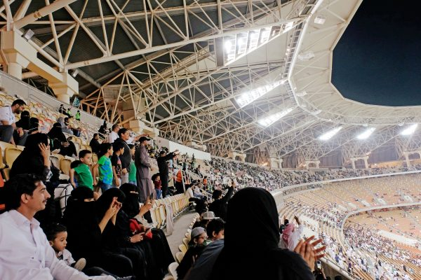 Saudi women watch the soccer match