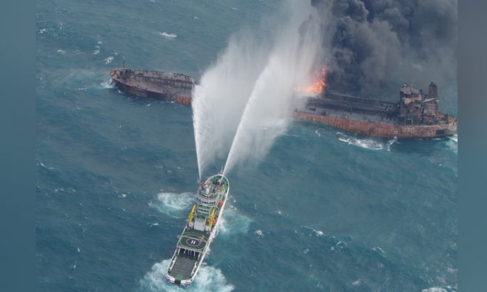 A rescue ship works to extinguish the fire on the stricken Iranian oil tanker Sanchi in the East China Sea, on Jan. 10, 2018 in this photo provided by Japan's 10th Regional Coast Guard. (10th Regional Coast Guard Headquarters/Handout via Reuters)
