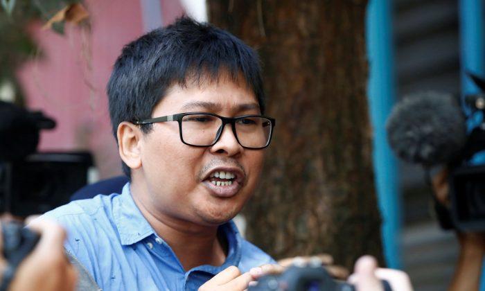 Reuters journalist Wa Lone speaks outside the court in Yangon, Burma on Jan. 10, 2018. (Reuters/Stringer)