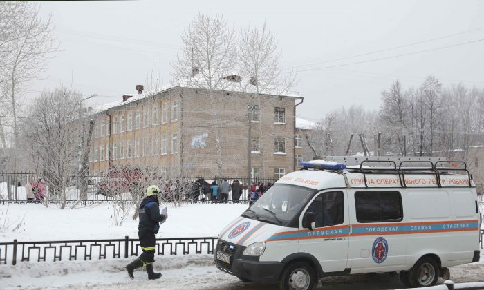 A vehicle of the Russian Emergencies Ministry is parked near a local school after reportedly several unidentified people wearing masks injured schoolchildren with knives in the city of Perm, Russia Jan. 15, 2018. (Reuters/Maksim Kimerling)