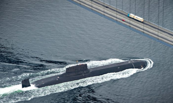 In this July 2017 file photo, the Russian nuclear submarine Dmitrij Donskoj sails under the Great Belt Bridge between Jyutland and Fun through Danish waters, near Korsor on it's way to Saint Petersburg to participate in the 100th anniversary of the Russian Navy on July 21, 2017. (Michael Bager/AFP/Getty Images)