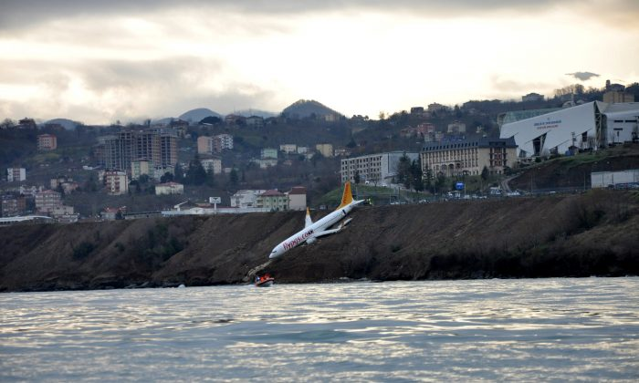A Pegasus Airlines aircraft is pictured after it skidded off the runway at Trabzon airport by the Black Sea in Trabzon, Turkey, Jan. 14, 2018. (Muhammed Kacar/Dogan News Agency via Reuters)