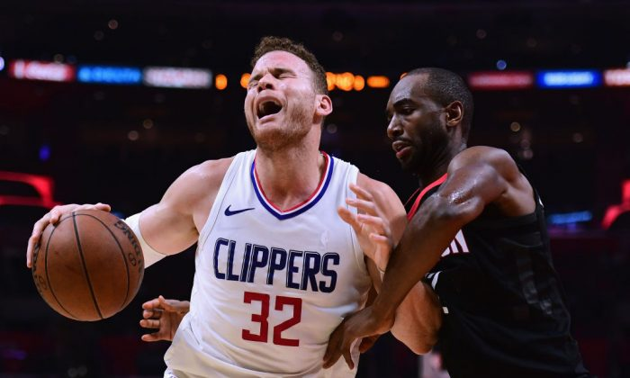 Blake Griffin of the LA Clippers reacts as he posts up Luc Mbah a Moute of the Houston Rockets on January 15, 2018 in Los Angeles, California. (Photo by Harry How/Getty Images)