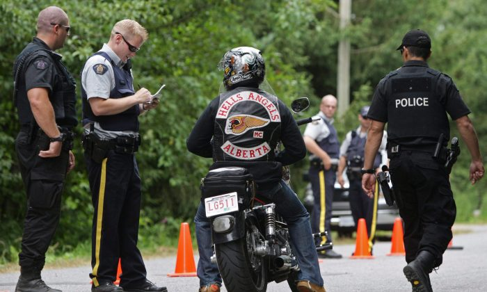 RCMP officers stop an Alberta member of the Hell's Angels motorcycle gang at a roadblock in Langley, B.C., in this file photo. Efforts by outlaw motorcycle gangs to expand in the Halifax area have prompted an RCMP request for more front-line officers. (The Canadian Press/ Darryl Dyck)