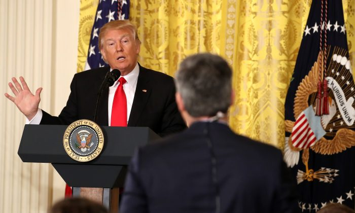 President Donald Trump answers a question from CNN's Jim Acosta during a news conference announcing Alexander Acosta as the new Labor Secretary nominee in the East Room at the White House in Washington, DC, on Feb. 16, 2017.