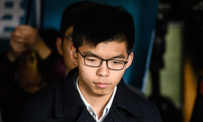 Pro-democracy activist Joshua Wong prepares to enter the High Court to hear his sentence on a protest related charge in Hong Kong on Jan. 17, 2018.  (ANTHONY WALLACE/AFP/Getty Images)