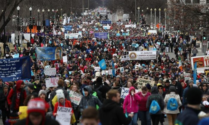 Thousands of people march on Constitution Avenue during the March for Life in Washington, DC, on Jan. 27, 2017. This year marks the 44th anniversary of the landmark Roe v. Wade Supreme Court case, which established a woman's constitutional right to an abortion. (Win McNamee/Getty Images)