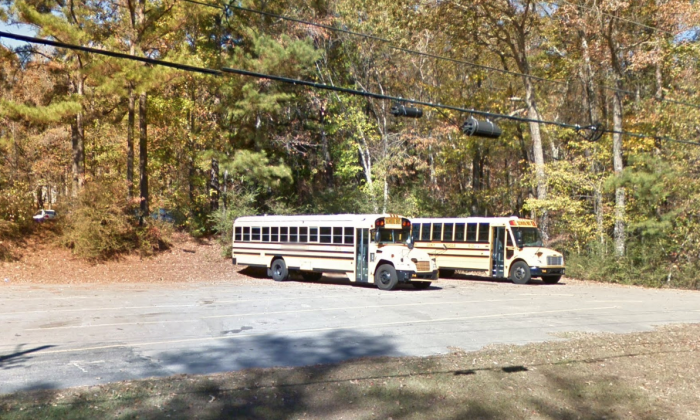Two school buses outside Grantswood Community School, where a 5-year-old was abandoned on a bus for the day. (Screenshot/GoogleMaps/Screenshot)