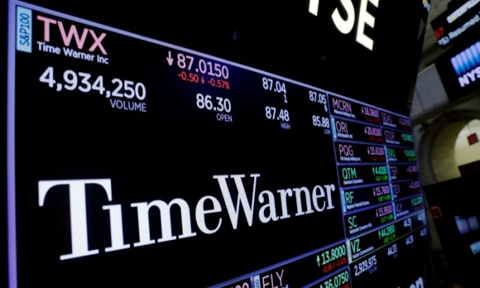 A screen shows the current price of Time Warner shares, above the floor of the New York Stock Exchange, shortly after the opening bell in New York, U.S. on Nov. 15, 2017. (Reuters/Lucas Jackson/File Photo)