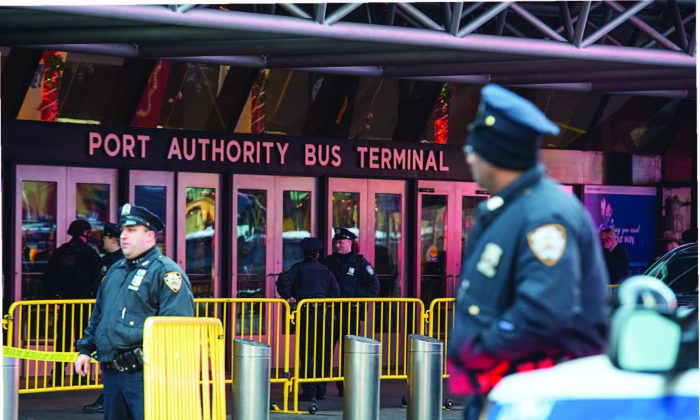 NYPD officers respond to an explosion at the New York Port Authority Bus Terminal in New York on Dec. 11, 2017. Akayed Ullah, a Bangladeshi national who entered the United States on a visa obtained through extended family migration, is in custody for the attempted terror attack. (BRYAN R. SMITH/AFP/GETTY IMAGES)