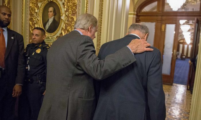 Senator Tom Carper (D-DE) and Senate Minority Leader Chuck Schumer (D-NY) (L-R) walk out of a Democratic Caucus meeting at the US Capitol on Jan. 19, 2018 in Washington, DC. A continuing resolution to fund the government has passed the House of Representatives but faces a stiff challenge in the Senate. (Tasos Katopodis/Getty Images)