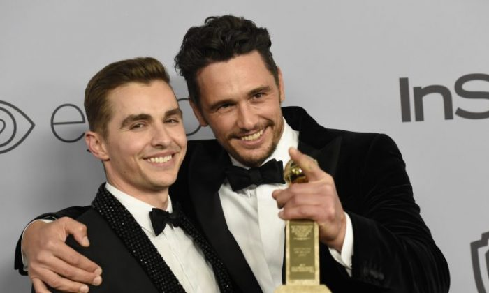 """Dave Franco (left), poses with James Franco, winner of the award for best performance by an actor in a motion picture - musical or comedy for """"The Disaster Artist,"""" at the InStyle and Warner Bros on Jan. 7, 2018. (Chris Pizzello/Invision/AP, File)"""