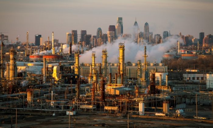 The Philadelphia Energy Solutions oil refinery owned by The Carlyle Group is seen at sunset in front of the Philadelphia skyline on March 24, 2014. (David M. Parrott/File Photo/Reuters)