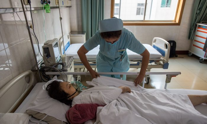 A woman is treated at a hospital in Xi'an, in China's Shaanxi Province on August 11, 2017. (STR/AFP/Getty Images)