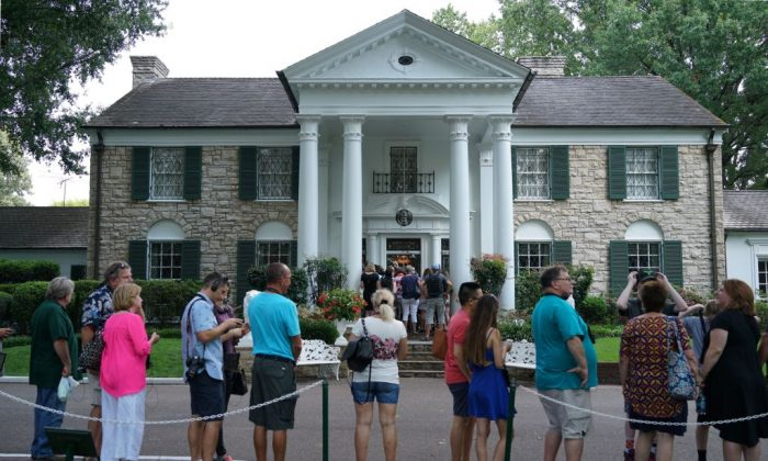 Visitors in line to enter the Graceland mansion of Elvis Presley on Aug. 12, 2017 in Memphis, Tennessee. (Mandel Ngan/AFP/Getty Images)