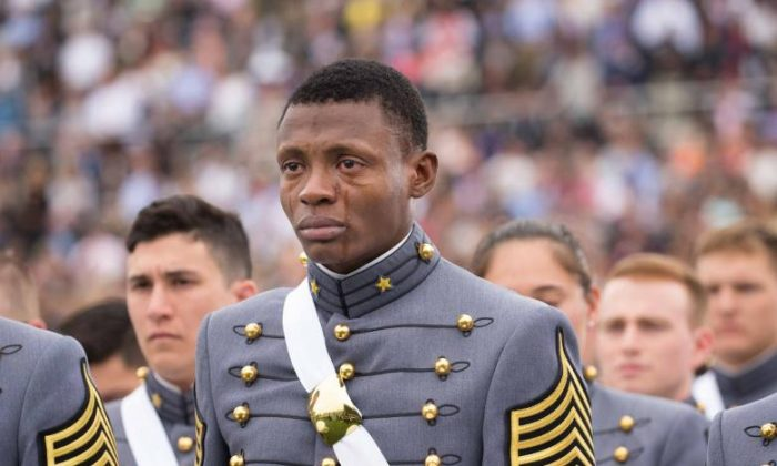 2nd Lt. Alix Schoelcher Idrache cries during the United States Military Academy West Point Graduation, May 23, 2016. (U.S. Army Staff Sgt. Vito T. Bryant)
