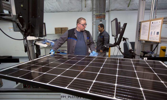 Production operator John White checks a panel at the SolarWorld solar panel factory in Hillsboro, Oregon, U.S., Jan. 15, 2018. (Reuters/Natalie Behring)