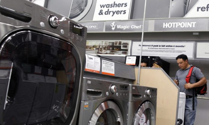 Shoppers look at washers and dryers at a Home Depot store in New York, July 29, 2010. (Reuters/Shannon Stapleton)