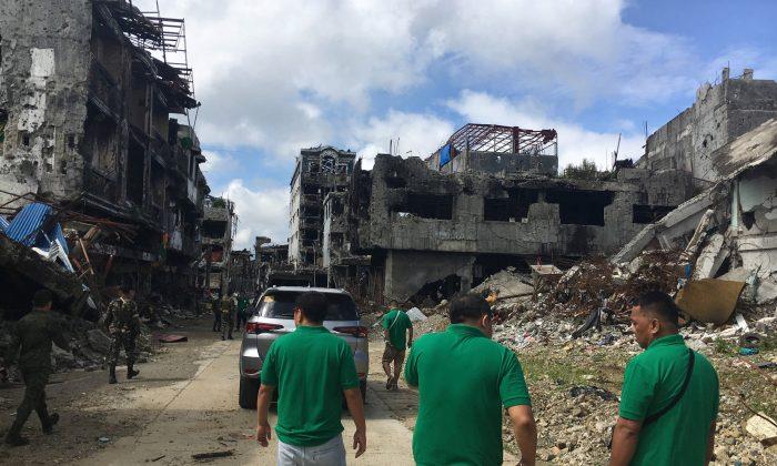 Community leaders survey damaged houses and buildings inside war-torn Marawi, Philippines Jan. 13, 2018.  (Reuters/Tom Allard)