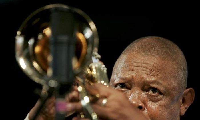 South African musician Hugh Masekela plays a trumpet at the New Orleans Jazz and Heritage Festival in New Orleans, Louisiana  April 26, 2009. (Reuters/Lee Celano)