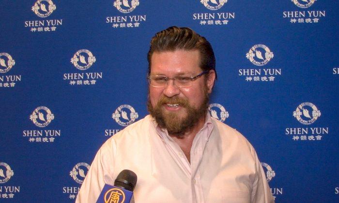 Finance Director Sees Love, Peace, Tolerance in Shen Yun