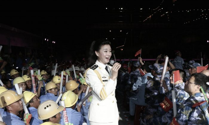 Chinese folk singer Song Zuying performing for workers and military personnel on Fiery Cross Reef located in the disputed Spratly Islands group in the South China Sea, on May 2, 2016.(STR/AFP/Getty Images)