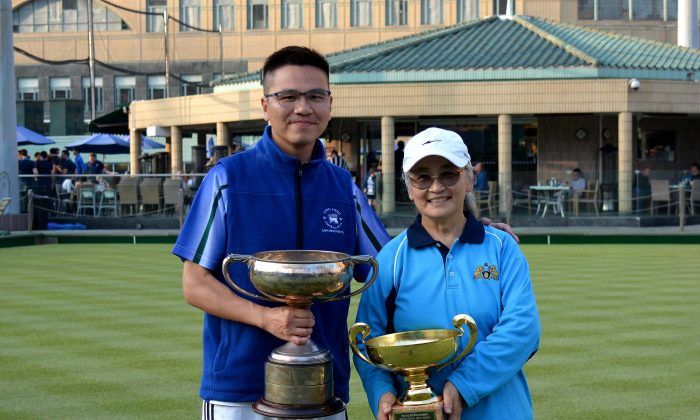Tony Cheung from Hong Kong Football Club (left) and Shirley Ko of Indian Recreation Club proudly display their National Singles trophy after winning their respective finals on Sunday Jan 21. (Stephanie Worth)