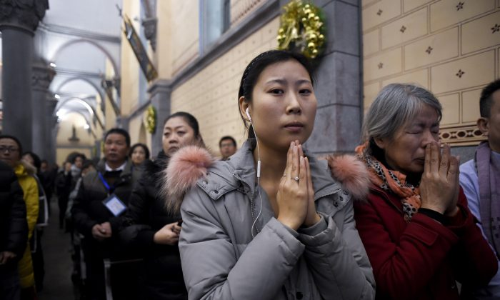 Chinese Christians attend Christmas Eve mass at a Catholic church in Beijing, on Dec. 24, 2016. (Wang Zhao/AFP/Getty Images)
