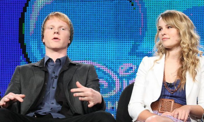 "Actors Adam Hicks and Bridgit Mendler speak at Disney ABC Television Group's TCA ""Winter Press Tour"" Panels at The Langham Hotel in Pasadena, California on Jan. 10, 2011. (Photo by Frederick M. Brown/Getty Images)"