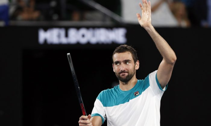 Croatia's Marin Cilic celebrates winning his semi-final match against Britain's Kyle Edmund on Jan. 25 at the Australiam Open in Melbourne, Australia. (Reuters/Issei Kato)