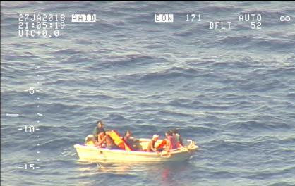A handout photo supplied by the New Zealand Defence Force shows survivors from a ferry that sunk floating in a boat in the sea near the South Pacific nation of Kiribati, January 27, 2018. Picture taken January 27, 2018. (New Zealand Defence Force/Handout via Reuters)